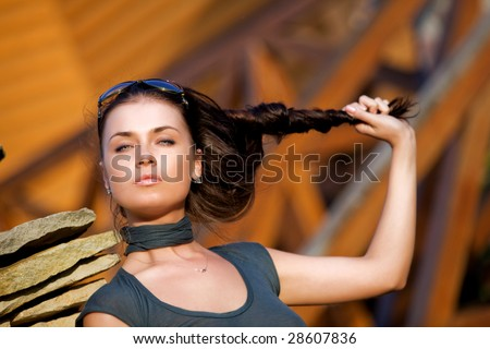 Young attractive woman outdoors - stock photo