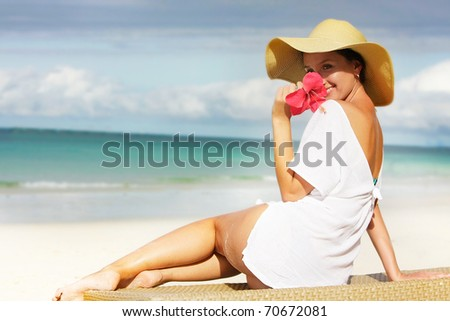young attractive woman relaxing on beach - stock photo
