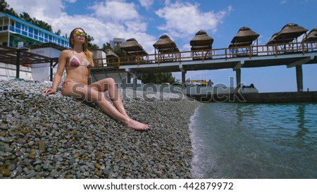 Young attractive woman relaxing on the beach. She relaxed and happy.