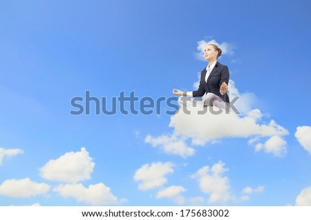 Young attractive woman sitting on cloud and meditating