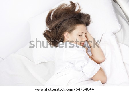 young attractive woman sleeping in bed - stock photo