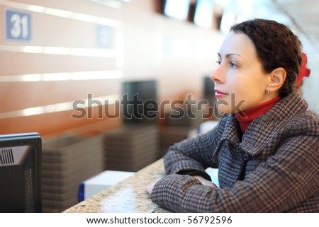 young attractive woman standing at airport side view portrait - stock photo