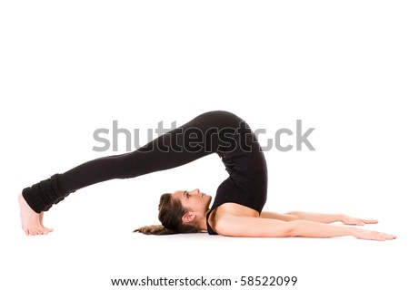 young attractive woman stretching, studio shoot isolated on white background - stock photo