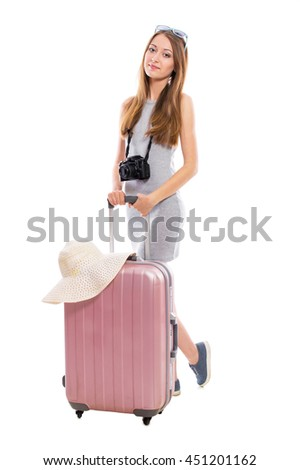Young attractive woman tourist with a suitcase and a camera isolated on white background. Recreation and tourism concept. - stock photo