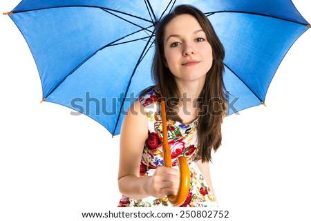 Young attractive woman under umbrella - stock photo