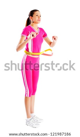 Young attractive woman with a hula hoop - stock photo