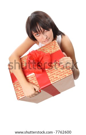 Young attractive woman with big golden giftbox decorated with red bow in her hands - stock photo