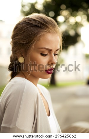 young attractive woman with burgundy lipstick - stock photo