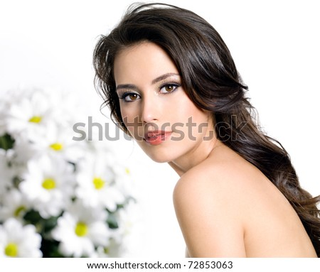 Young attractive woman with clean skin and bouquet of  flowers - isolated on white - stock photo