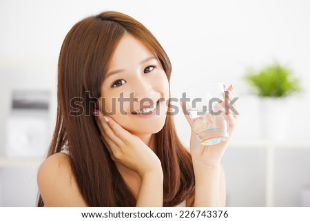 Young attractive woman with clean water - stock photo