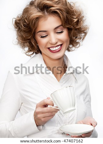 young attractive woman with cup on white background - stock photo