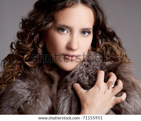 young attractive woman with curly hair