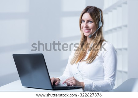 Young attractive woman with headset and laptop
