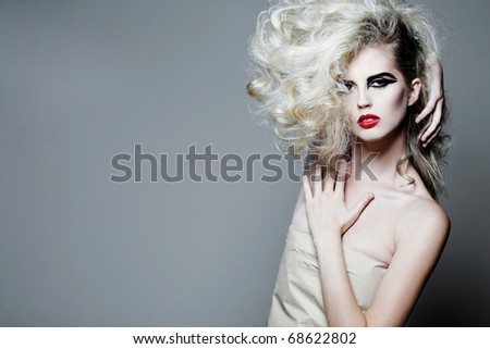 Young attractive woman with long curly hair. - stock photo
