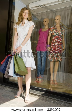 Young attractive woman with paper bags shopping