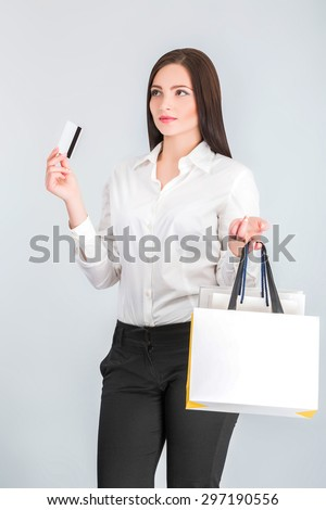 Young attractive woman with shopping bags and credit card  - stock photo