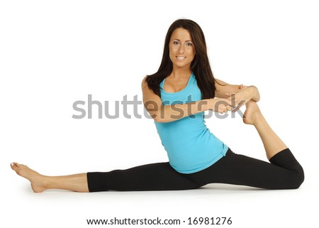 Young attractive women in her early 20's showing her flexibility doing the splits.