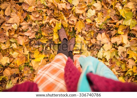 Young autumnal dressed woman standing in the park