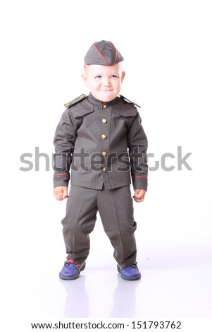Young baby boy. Dressed in military stuff. USSR army. military school. - stock photo