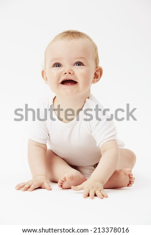 Young baby boy with mouth open, studio  - stock photo