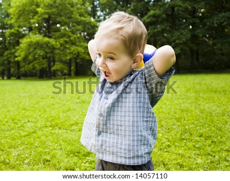 Young Baby Playing With Ball Outdoors - stock photo