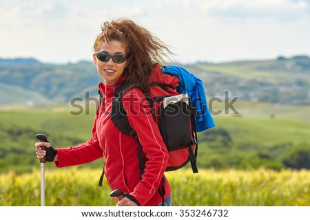Young backpacker traveling along Italy, female walking in the Tuscany, summer vacation concept - stock photo