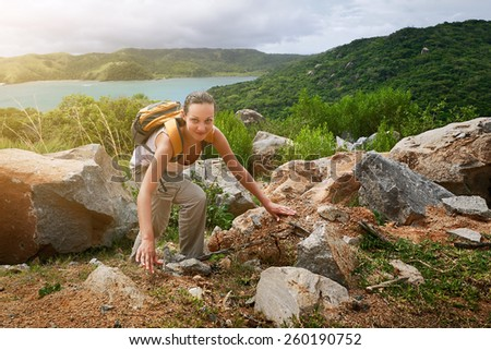 Young backpacker traveling along mountains, happy female walking in the park, discovering world, summer vacation concept - stock photo