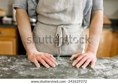Young baker preparing artisan sourdough bread. - stock photo