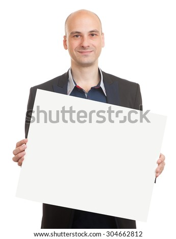 Young bald man in black suit holding a blank sheet of paper isolated - stock photo