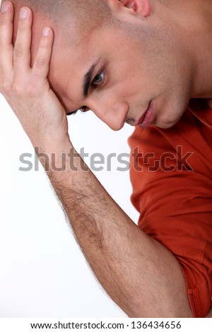 Young bald man in deep thought - stock photo