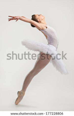 Young ballerina dancer in tutu performing on pointes  - stock photo