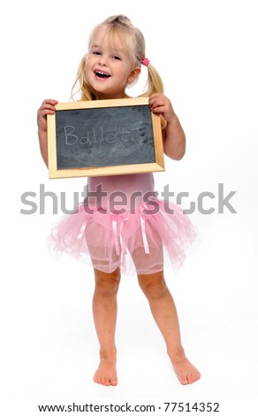 young ballerina smiling in studio holding ballet sign - stock photo