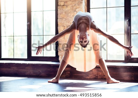 Young ballet dancer demonstrating flexibility