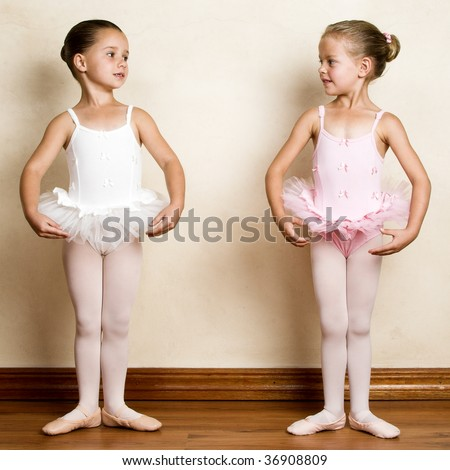 Young ballet dancer in a studio with wooden floors