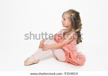 Young ballet dancer wearing an apricot tutu - stock photo