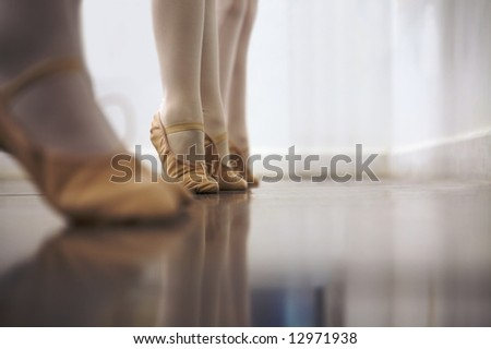 Young ballet dancers are learning to balance - stock photo