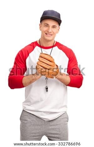 Young baseball coach with a baseball glove looking at the camera isolated on white background - stock photo