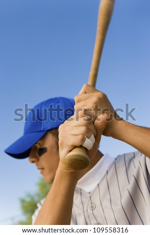 Young baseball player getting ready to hit the ball - stock photo