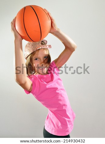 Young basketball player exercising with a ball, making a  throw. Sports active childhood lifestyle concept. - stock photo