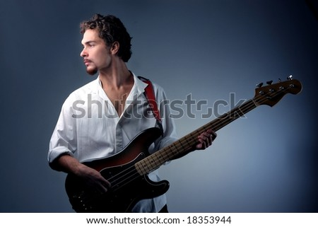 young bass guitar player - stock photo