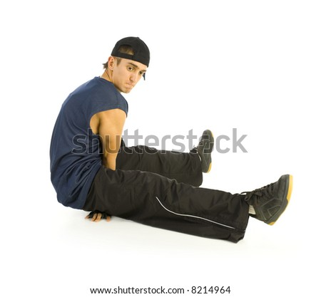 Young bboy holding up on hands and head. Holding legs in air. Isolated on white in studio. Side view, whole body - stock photo