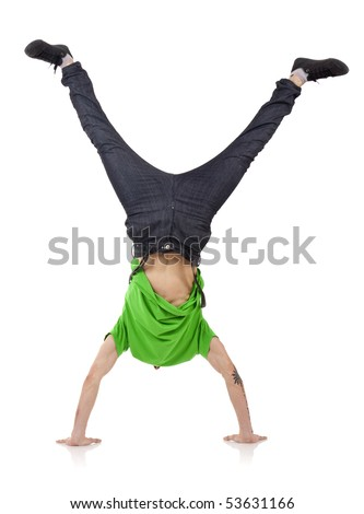 Young bboy standing on hands. Holding legs in air. - stock photo