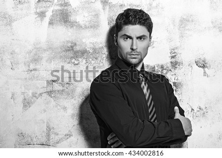 Young bearded man in studio - stock photo