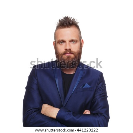 Young bearded man isolated at white background. Close up portrait of a confident guy with beard looking at camera. Boy style, trendy hipster look with cool hairstyle in blue suit. Modern businessman. - stock photo