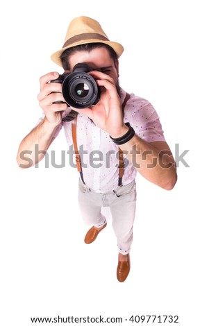 Young bearded traveler man with photo camera on white background