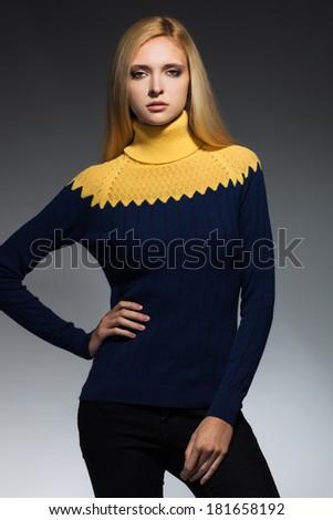 Young beautiful adult girl wearing elegant winter sweater Studio shot - stock photo