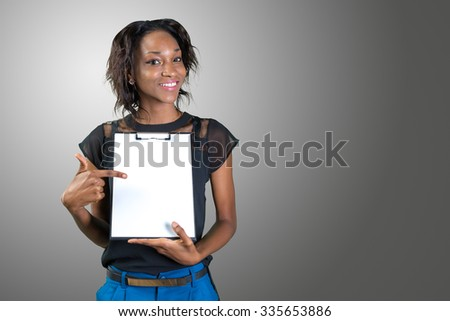 Young beautiful african american woman showing clipboard with copy space - stock photo