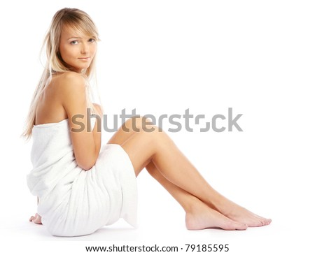 Young, beautiful and very cute lady relaxing in spa - stock photo