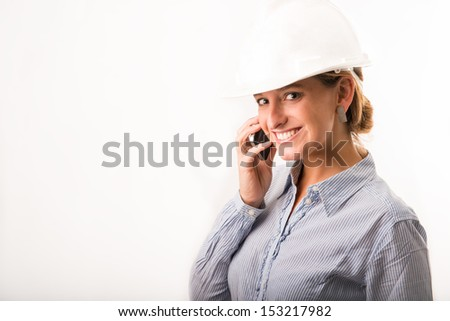 Young beautiful Architect on the phone - stock photo