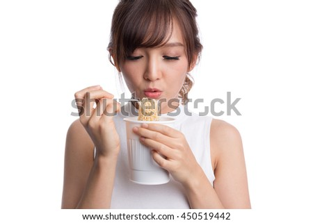 Young beautiful asian girl eating instant noodle using plastic fork.